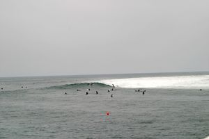 Surfers enjoying the growing waves